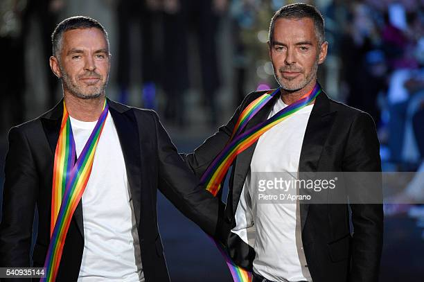 Designers Dan Caten and Dean Caten acknowledge the applause of the audience after the Dsquared2 show during Milan Men's Fashion Week Spring/Summer...
