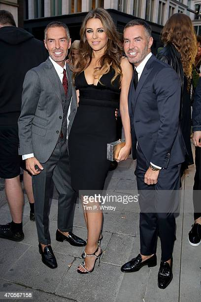 D2 designers Dan Caten and Dean Caten and actress Elizabeth Hurley attend the DSQUARED2 celebration of London Flagship Opening on April 21 2015 in...