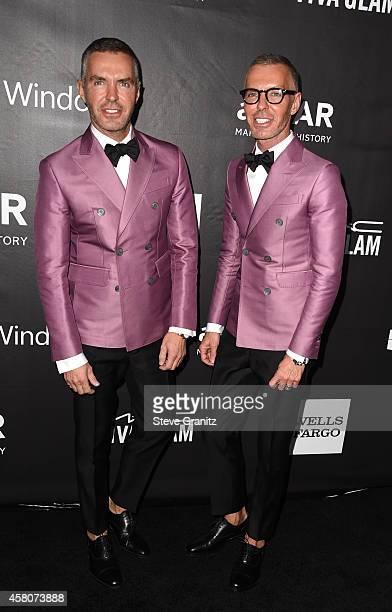 Designers Dan Caten and Dean Caten attend amfAR LA Inspiration Gala honoring Tom Ford at Milk Studios on October 29 2014 in Hollywood California