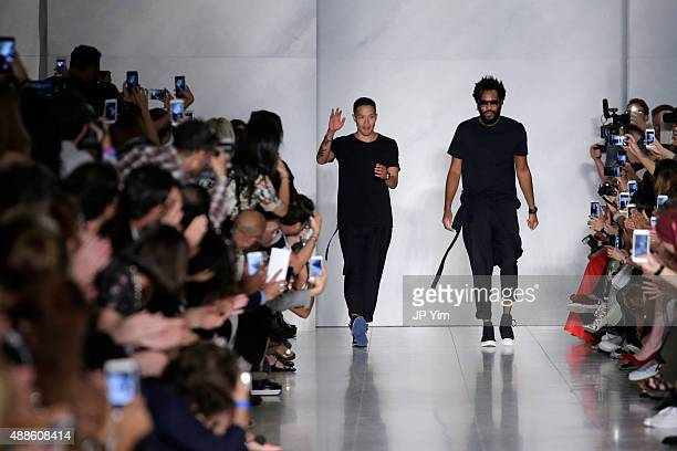 Designers DaoYi Chow and Maxwell Osborne pose on the runway at the DKNY Women's Spring 2016 fashion show during New York Fashion Week The Shows on...