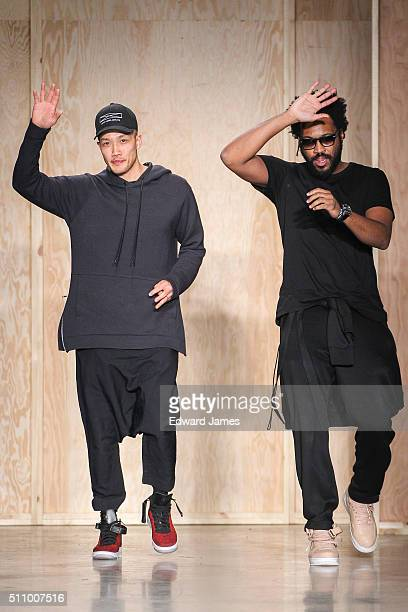 Designers DaoYi Chow and Maxwell Osborne walk the runway during the DKNY fashion show at Skylight Modern on February 17 2016 in New York City