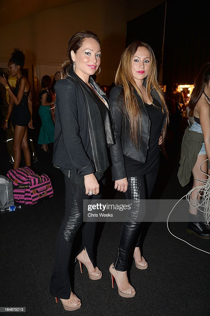 Designers Darcey Silva and Stacey Silva attend the Octavio Carlin Spring 2014 collection show at Style Fashion Week on October 14, 2013 in Los Angeles, California.