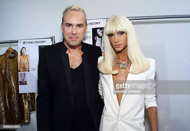 Designers David Blond and Phillipe Blond pose for a photo backstage at The Blonds fashion show during Spring 2016 MADE Fashion Week at Milk Studios...
