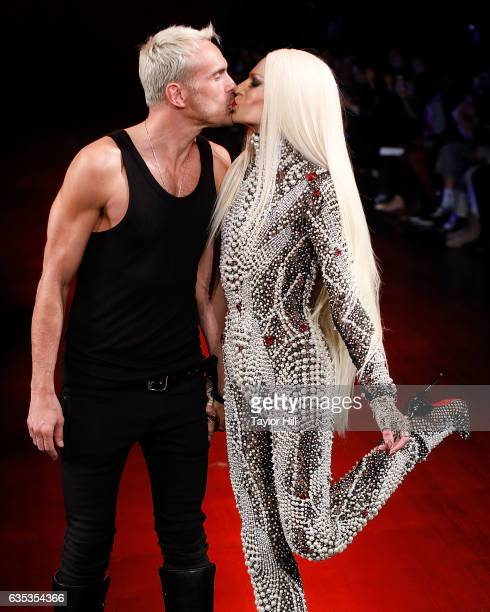Designers David Blond and Phillipe Blond walk the runway and kiss during The Blonds' Fall 2017 fashion show during New York Fashion Week at Gallery 1...