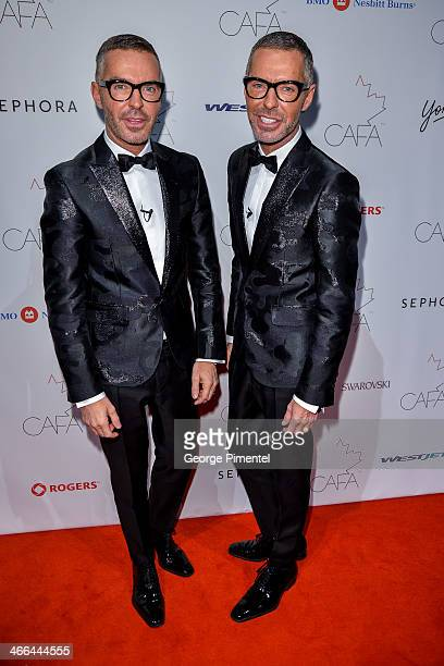 Designers Dean and Dan Caten arrive at the 1st Annual Canadian Arts and Fashion Awards at the Fairmont Royal York Hotel on February 1 2014 in Toronto...