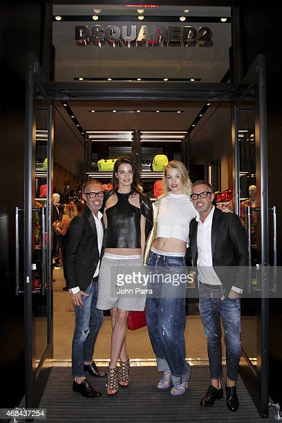 DSQUARED2 designers Dean Caten and Dan Caten pose with models Daphne GroeneveldÊ and Rianne ten Haken at DSQUARED2 Bal Harbour Flagship Opening at...