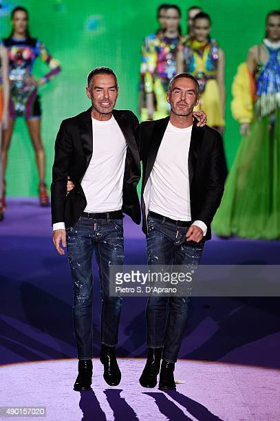 Designers Dean Caten and Dan Caten walks the runway after the DSquared2 fashion show as part of Milan Fashion Week Spring/Summer 2016 on September 26...