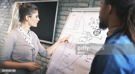 Designers discussing a project. : Stockfoto