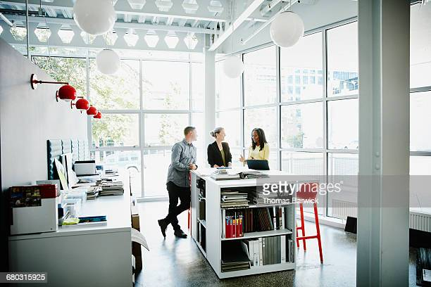Designers discussing project in sample library