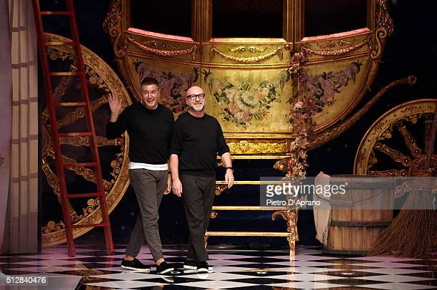 Designers Domenico Dolce and Stefano Gabbana ackowledge the applause of the audience at the end of Dolce Gabbana show during Milan Fashion Week...
