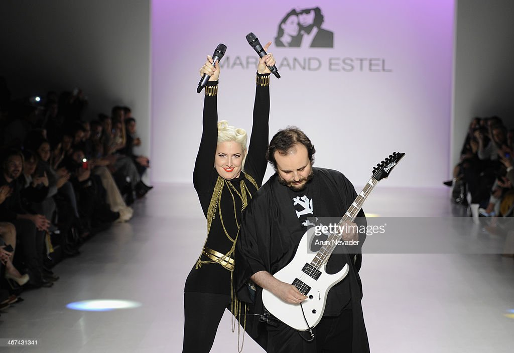 Designers Estel Day (L) and Mark Tango pose on the runway at Mark And Estel fashion show during Mercedes-Benz Fashion Week Fall 2014 at The Salon at Lincoln Center on February 6, 2014 in New York City.