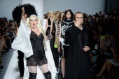 Designers Estel Day and Mark Tango walk the runway at the Mark And Estel fashion show during MercedesBenz Fashion Week Spring 2014 at The Studio at...