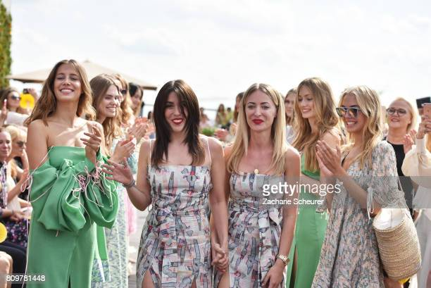 Designers Gelena Roizen and Lana Mueller acknowledge the applause of the audience the Lana Mueller show during the MercedesBenz Fashion Week Berlin...