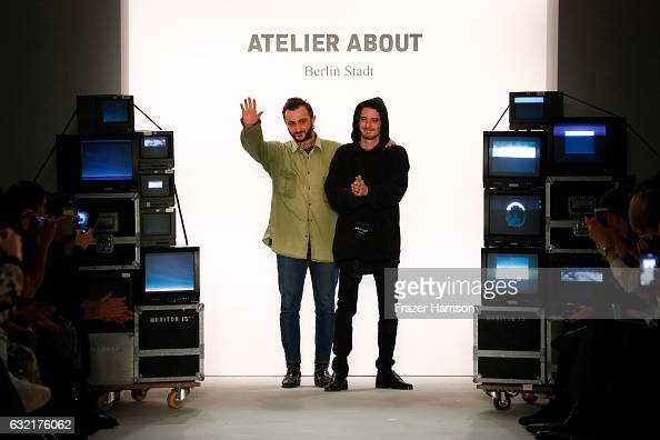 Designers Gianpaolo Tucci and Giulio D'Alessio acknowledge the audience after their Atelier About show during the MercedesBenz Fashion Week Berlin...