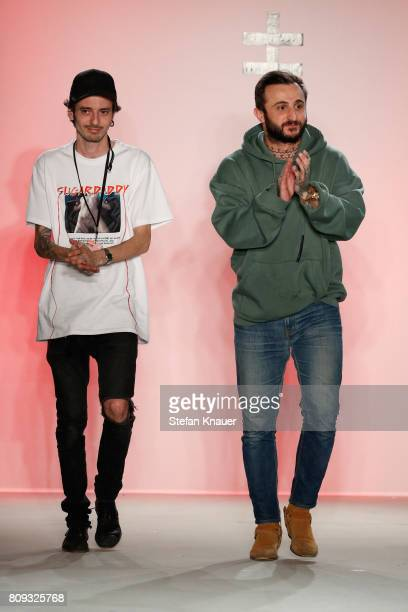 Designers Gianpaolo Tucci and Giulio D'Alessio acknowledge the audience after theirthe Atelier About show during the MercedesBenz Fashion Week Berlin...