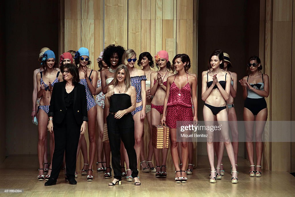 Designers Guillermina Baeza (L) and Belen Larruy (R) pose with models at the runway during the Guillermina Baeza show as part of the 080 Barcelona Fashion Spring/Summer 2015 on July 3, 2014 in Barcelona, Spain.