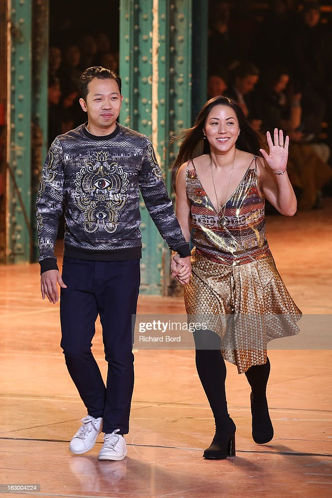 Designers Humberto Leon and <a gi-track='captionPersonalityLinkClicked' href=/galleries/search?phrase=Carol+Lim&family=editorial&specificpeople=4081625 ng-click='$event.stopPropagation()'>Carol Lim</a> walk the runway during the Kenzo Fall/Winter 2013 Ready-to-Wear show as part of Paris Fashion Week at La Samaritaine on March 3, 2013 in Paris, France.