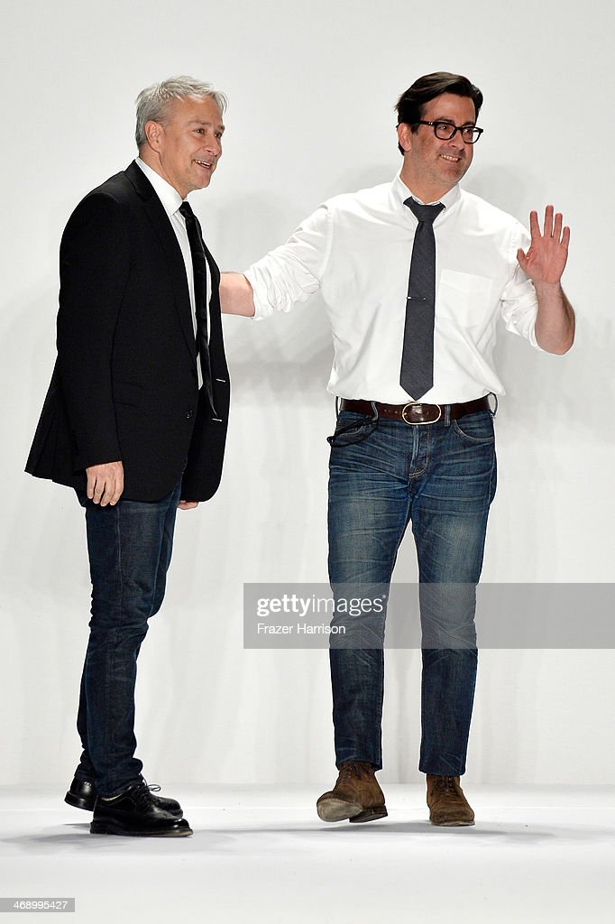 Designers Isaac Franco and Ken Kaufman walk the runway at the Kaufmanfranco fashion show during MercedesBenz Fashion Week Fall 2014 at The Theatre at...