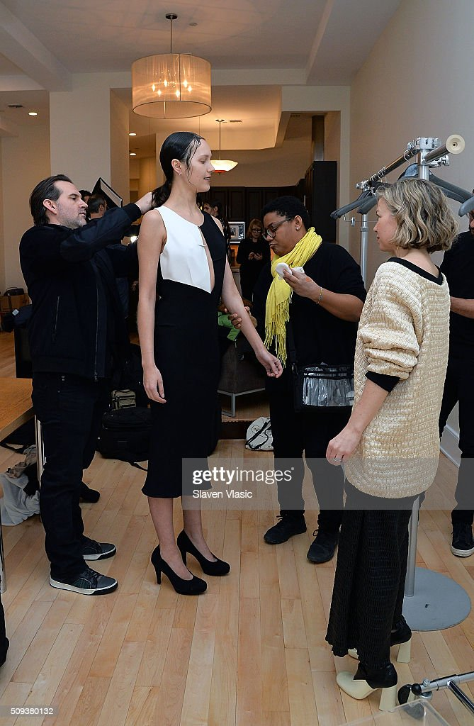 Designers Jason Alkire (L) and Julie Haus (R) attend models preparation backstage at Haus Alkire Presentation during Fall 2016 New York Fashion Week on February 10, 2016 in New York City.