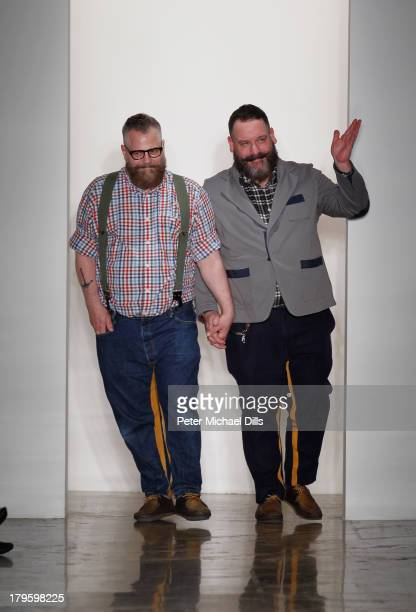 Designers Jeffrey Costello and Robert Tagliapietra walk the runway at the Costello Tagliapietra fashion show during MADE Fashion Week Spring 2014 at...