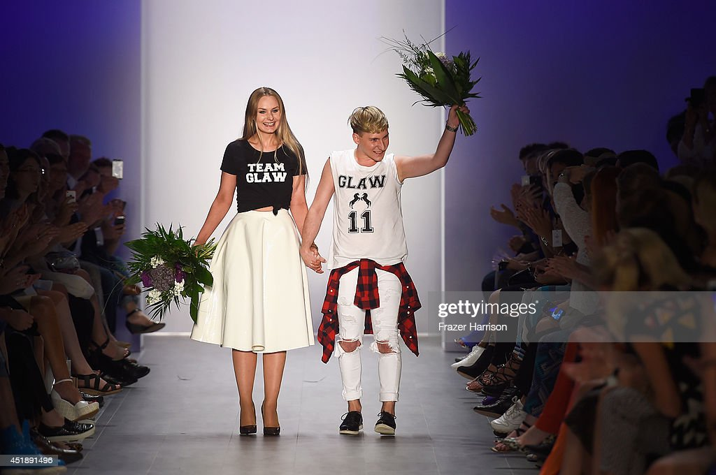 Designers Jesko Wilke and Maria Poweleit acknowledge the audience at the Glaw show during the Mercedes-Benz Fashion Week Spring/Summer 2015 at Erika Hess Eisstadion on July 9, 2014 in Berlin, Germany.