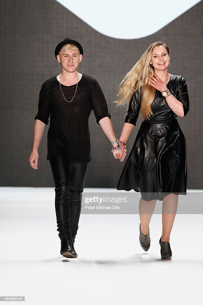 Designers Jesko Wilke and Maria Poweleit acknowledge the audience at the Glaw show during Mercedes-Benz Fashion Week Autumn/Winter 2014/15 at Brandenburg Gate on January 16, 2014 in Berlin, Germany.