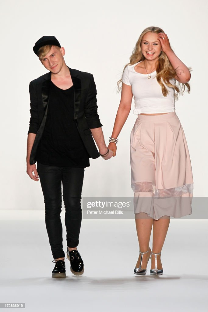 Designers Jesko Wilke and Maria Poweleit walk the runway at the Glaw Show during Mercedes-Benz Fashion Week Spring/Summer 2014 at Brandenburg Gate on July 5, 2013 in Berlin, Germany.