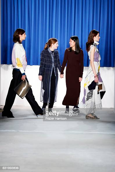 Designers Johanna Perret and Tutia Schaad acknowledge the audience following their show during the MercedesBenz Fashion Week Berlin A/W 2017 at...
