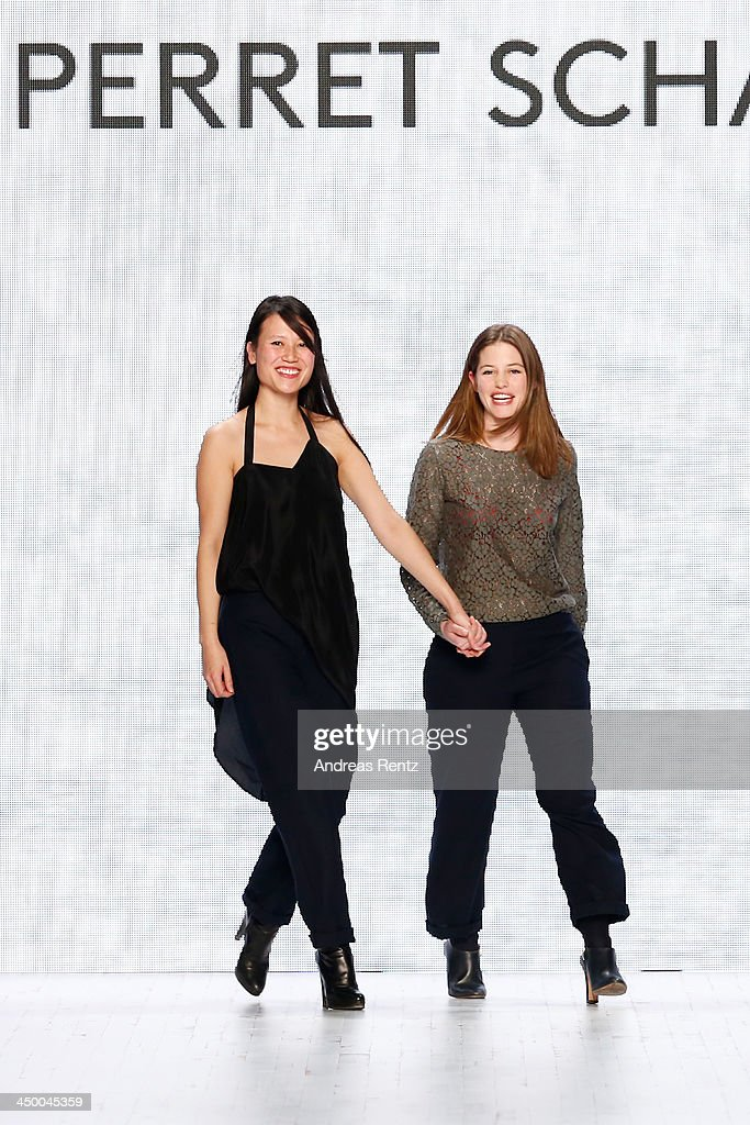 Designers <a gi-track='captionPersonalityLinkClicked' href=/galleries/search?phrase=Johanna+Perret&family=editorial&specificpeople=6699466 ng-click='$event.stopPropagation()'>Johanna Perret</a> and <a gi-track='captionPersonalityLinkClicked' href=/galleries/search?phrase=Tutia+Schaad&family=editorial&specificpeople=6699467 ng-click='$event.stopPropagation()'>Tutia Schaad</a> on the runway after the Perret Schaad show during Mercedes-Benz Fashion Days Zurich 2013 on November 16, 2013 in Zurich, Switzerland.