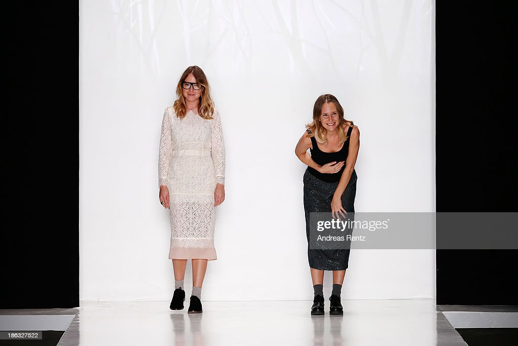 Designers Julia Ruban and Alisa Ruban appear at the end of the runway at the RUBAN show during Mercedes-Benz Fashion Week Russia S/S 2014 on October 30, 2013 in Moscow, Russia.