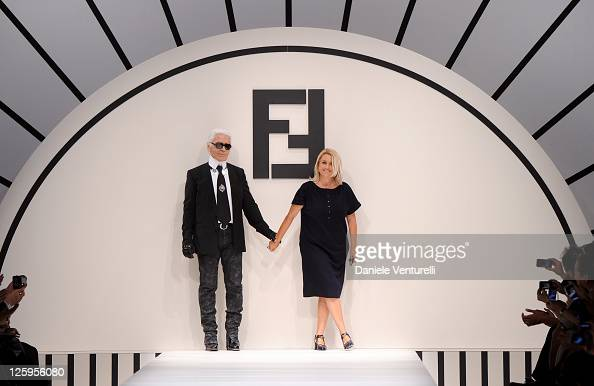 Designers Karl Lagerfeld and Silvia Venturini Fendi acknowledge the applause of the public after the Fendi Spring/Summer 2012 fashion show as part...