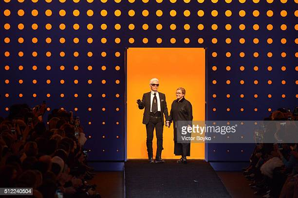 Designers Karl Lagerfeld and Silvia Venturini Fendi acknowledge the applause of the public after the Fendi show during Milan Fashion Week Fall/Winter...