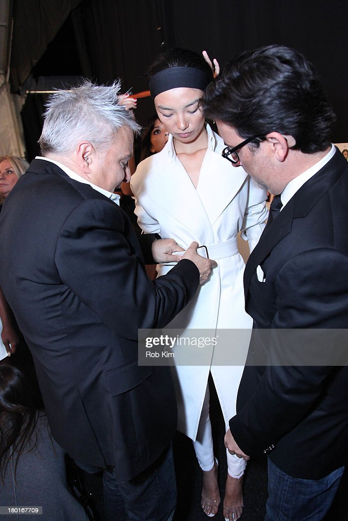Designers Ken Kaufman and Isaac Franco work with a model backstage at the Kaufmanfranco show during Spring 2014 MercedesBenz Fashion Week at The...