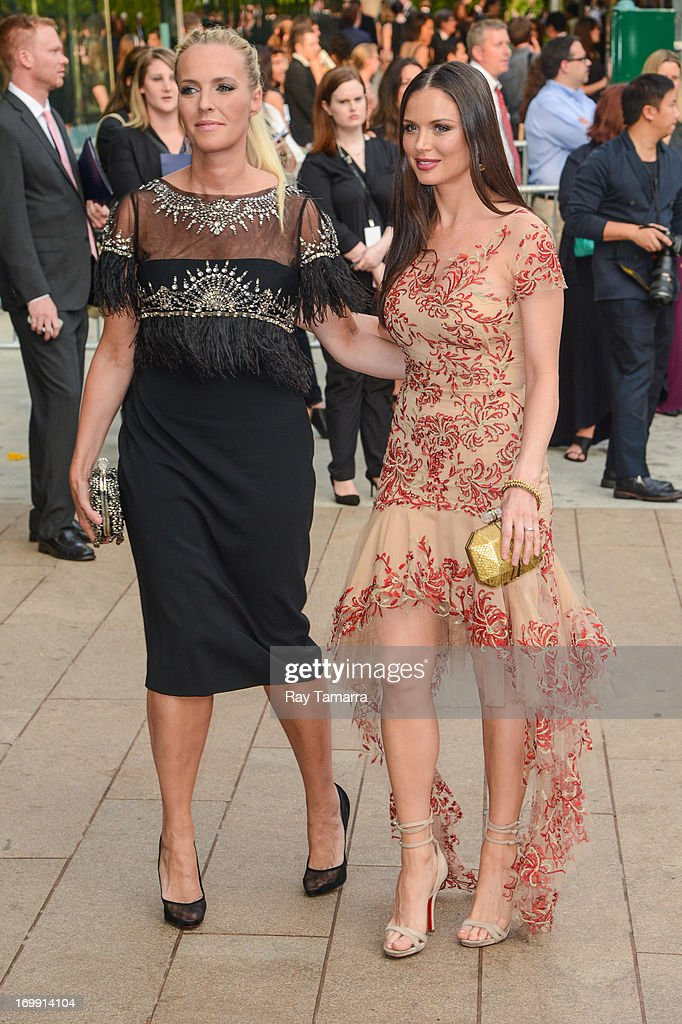 Designers Keren Craig (L) and Georgina Chapman enter the 2013 CFDA Fashion Awards on June 3, 2013 in New York, United States.