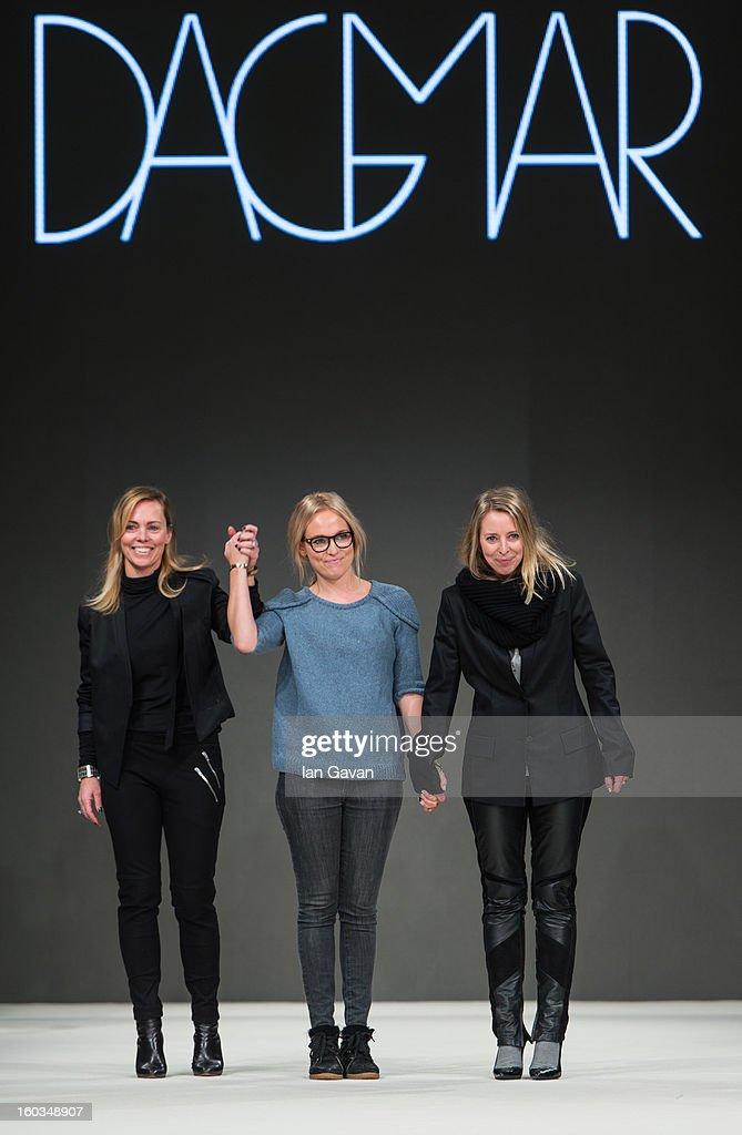 Designers Kristina Tjader, Sofia Wallenstam and Karin Soderlind appear on the runway after their Dagmar show at Mercedes-Benz Stockholm Fashion Week Autumn/Winter 2013 at Mercedes-Benz Fashion Pavilion on January 29, 2013 in Stockholm, Sweden.