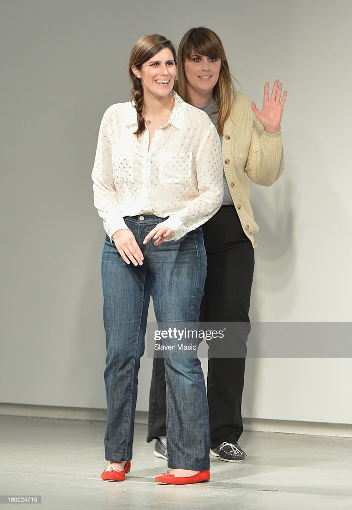 Designers Laura Mulleavy and Kate Mulleavy pose on the runway at the Rodarte fashion show during Mercedes-Benz Fashion Week Spring 2014 on September 10, 2013 in New York City.