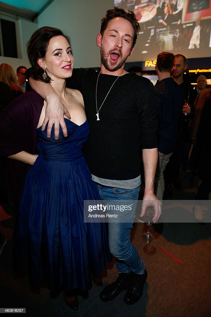 Designers <a gi-track='captionPersonalityLinkClicked' href=/galleries/search?phrase=Lena+Hoschek+-+Fashion+Designer&family=editorial&specificpeople=10119418 ng-click='$event.stopPropagation()'>Lena Hoschek</a> and Marcel Ostertag arrive for the Marcel Ostertag show during Mercedes-Benz Fashion Week Autumn/Winter 2014/15 at Brandenburg Gate on January 15, 2014 in Berlin, Germany.