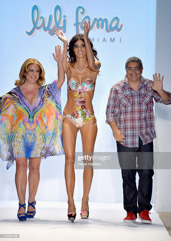 Designers <a gi-track='captionPersonalityLinkClicked' href=/galleries/search?phrase=Lourdes+Hanimian&family=editorial&specificpeople=5446415 ng-click='$event.stopPropagation()'>Lourdes Hanimian</a> (L) and <a gi-track='captionPersonalityLinkClicked' href=/galleries/search?phrase=Augusto+Hanimian&family=editorial&specificpeople=5446414 ng-click='$event.stopPropagation()'>Augusto Hanimian</a> (R) walk the runway at the Luli Fama show during Mercedes-Benz Fashion Week Swim 2014 at Cabana Grande at the Raleigh on July 21, 2013 in Miami, Florida.