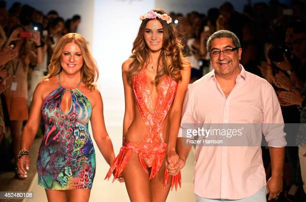 Designers Lourdes Hanimian and Augusto Hanimian walk the runway with a model during Luli Fama show at MercedesBenz Fashion Week Swim 2015 at Cabana...