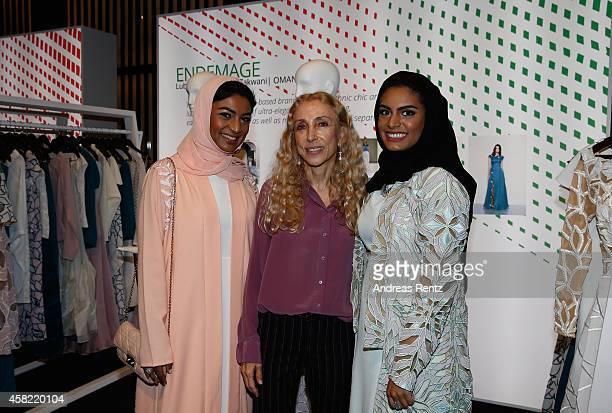 Designers Lubna and Nadia Al Zakwani of Endemage and Franca Sozzani are seen at the International Design Showcase during the Vogue Fashion Dubai...
