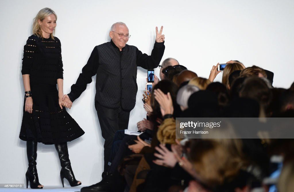 Designers Lubov and <a gi-track='captionPersonalityLinkClicked' href=/galleries/search?phrase=Max+Azria&family=editorial&specificpeople=4232905 ng-click='$event.stopPropagation()'>Max Azria</a> walk the runway at the Herve Leger By <a gi-track='captionPersonalityLinkClicked' href=/galleries/search?phrase=Max+Azria&family=editorial&specificpeople=4232905 ng-click='$event.stopPropagation()'>Max Azria</a> fashion show during Mercedes-Benz Fashion Week Fall 2014 at The Theatre at Lincoln Center on February 8, 2014 in New York City.