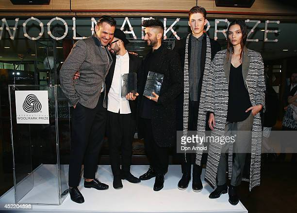 Designers MarioLuca Carlucci and Peter Strateas accept their award from Roland Mouret during the International Australian Regional Award Woolmark...