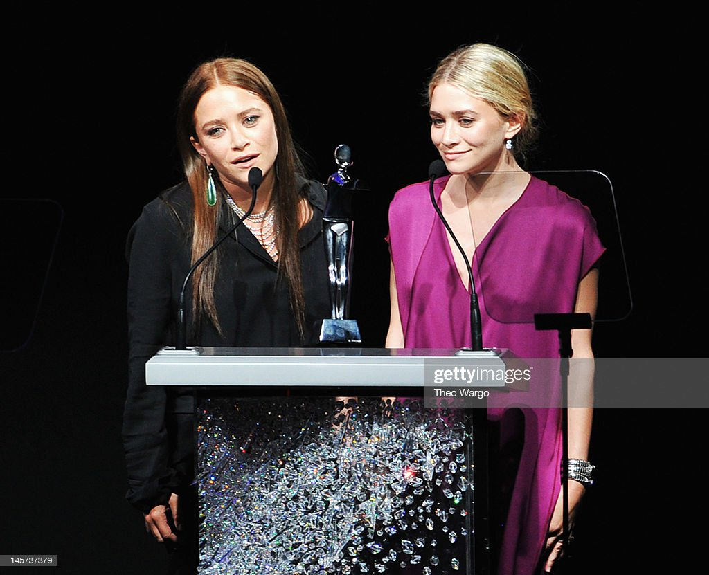 Designers Mary Kate Olsen and <a gi-track='captionPersonalityLinkClicked' href=/galleries/search?phrase=Ashley+Olsen&family=editorial&specificpeople=156429 ng-click='$event.stopPropagation()'>Ashley Olsen</a> receive Womenswear Designer of the Year Award on stage at the 2012 CFDA Fashion Awards at Alice Tully Hall on June 4, 2012 in New York City.