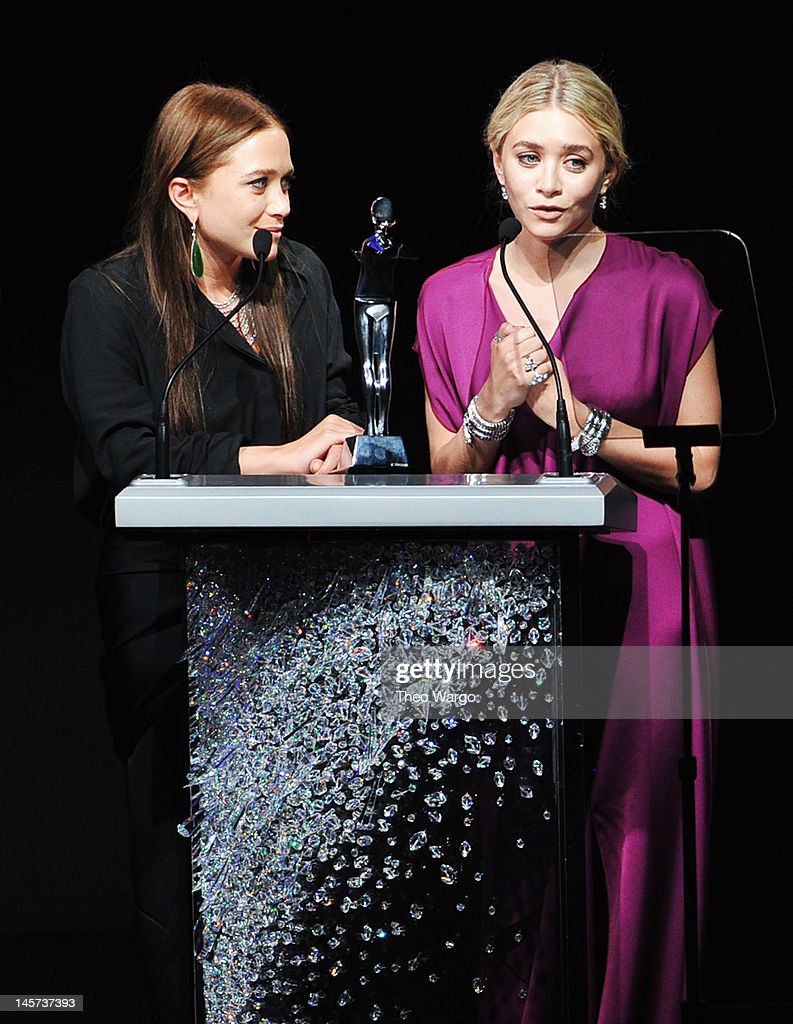 Designers Mary Kate Olsen and Ashley Olsen receive Womenswear Designer of the Year Award on stage at the 2012 CFDA Fashion Awards at Alice Tully Hall on June 4, 2012 in New York City.