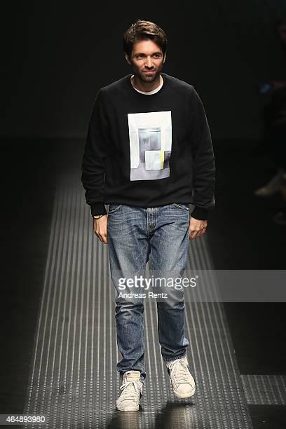 Designers Massimo Giorgetti acknowledges the applause of the audience after the MSGM show during the Milan Fashion Week Autumn/Winter 2015 on March 1...