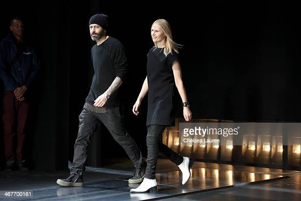 Designers Michael Covolos and Nicole Colovos walk the runway at the Helmut Lang fashion show during MercedesBenz Fashion Week Fall 2014 on February 7...