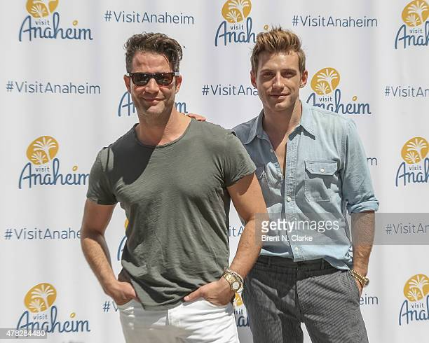 Designers Nate Berkus and Jeremiah Brent pose for photographs during the Anaheim/Orange County Visitor Conventions Bureau's New Brand Debut held at...