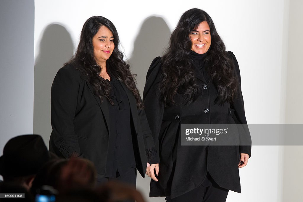 Designers Noor Rashid Al Khalifa (L) and Haya Mohammed Al Khalifa walk the runway at Noon By Noor Fall 2013 Mercedes-Benz Fashion Week at The Studio at Lincoln Center on February 8, 2013 in New York City.