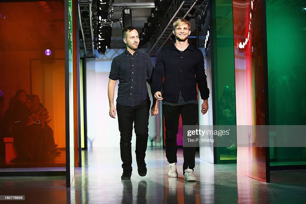 Designers Peter Pilotto and Christopher De Vos acknowledge the audience after the Peter Pilotto show during London Fashion Week SS14 at Victoria House on September 16, 2013 in London, England.