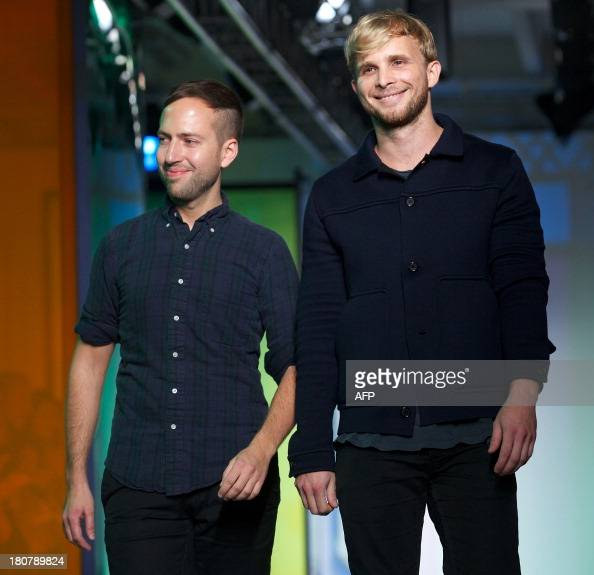 Designers Peter Pilotto and Christopher De Vos greet the audience following the 2014 Spring/Summer Peter Pilotto catwalk show during the London...